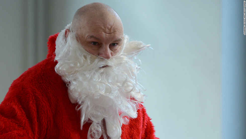 A man dressed as Santa Claus attends Berlin's meeting of volunteer Santa Clauses and angels on December 1 in Berlin.