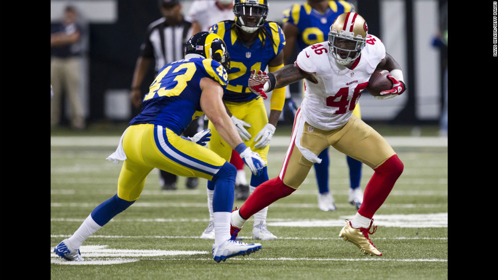 Tight end Delanie Walker of the San Francisco 49ers attempts to evade strong safety Craig Dahl of the St. Louis Rams on Sunday.