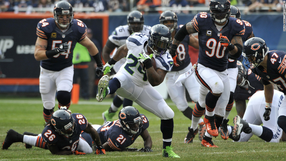 Marshawn Lynch of the Seattle Seahawks runs against the Chicago Bears defense on Sunday.