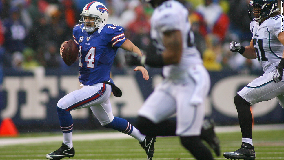 Quarterback Ryan Fitzpatrick of the Buffalo Bills runs for a first down against the Jacksonville Jaguars at Ralph Wilson Stadium on Sunday in Orchard Park, New York.
