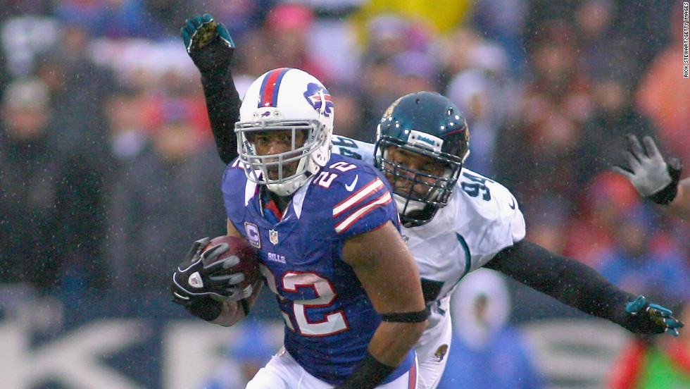 Fred Jackson of the Buffalo Bills runs ahead of Jeremy Mincey of the Jacksonville Jaguars on Sunday.
