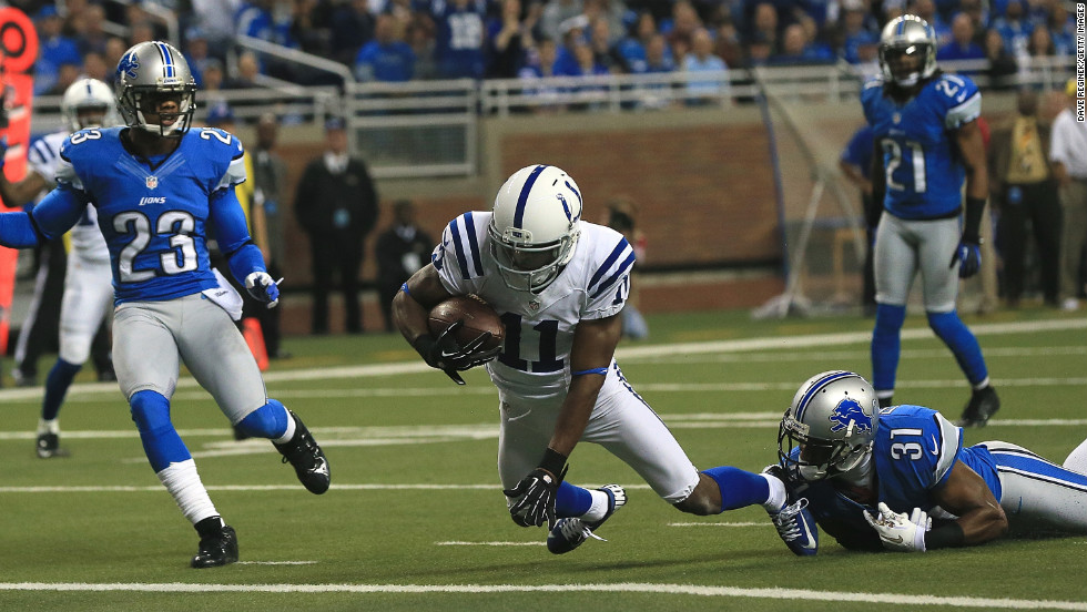 Donnie Avery of the Indianapolis Colts breaks the tackle of Drayton Florence of the Detroit Lions and scores a touchdown on Sunday.