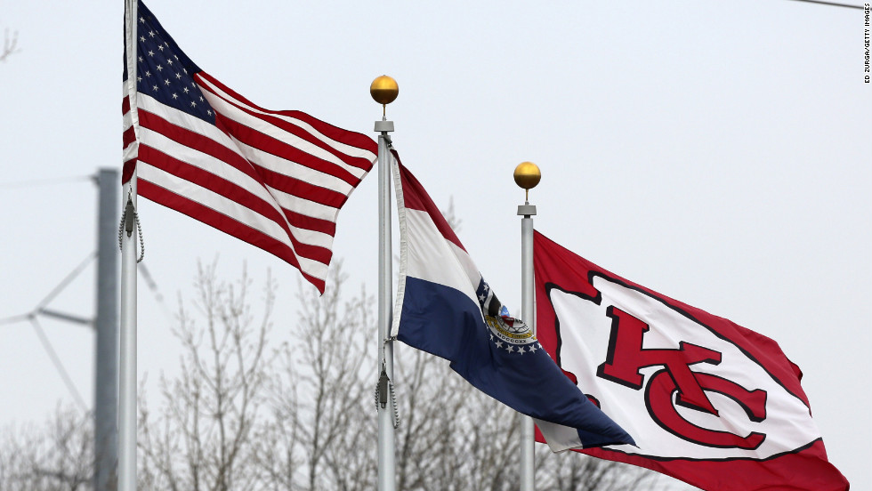 After Belcher and his girlfriend's deaths, flags wave in the wind outside of The University of Kansas Hospital Training Complex used by the Kansas City Chiefs next to Arrowhead Stadium, on Saturday, December 1, 2012.