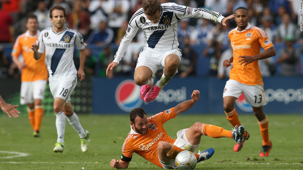 Beckham leaps over Houston's Brad Davis in the second half.
