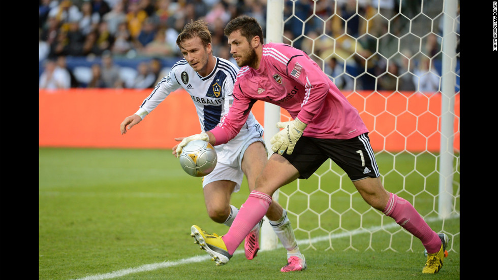 Beckham attempts to disrupt an inbound pass by Houston's goalie Tally Hall in the second half.