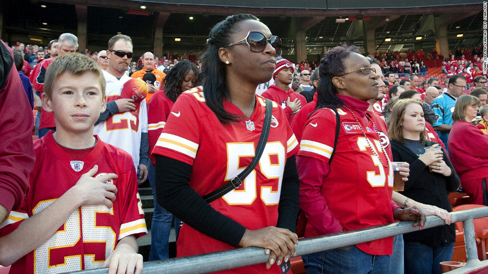 Natalie Samson wears the No. 59 jersey, which was Jovan Belcher's number, as she stands for a moment of silence.