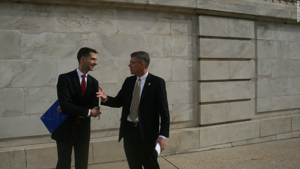 Cotton chats with Republican Rep. Erick Paulsen of Minnesota outside the Cannon House Office Building.