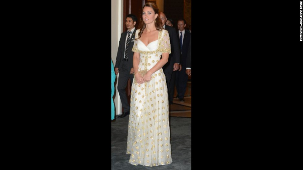The duchess donned a white and gold gown by Alexander McQueen for a dinner hosted by Malaysia's head of state on September 13.