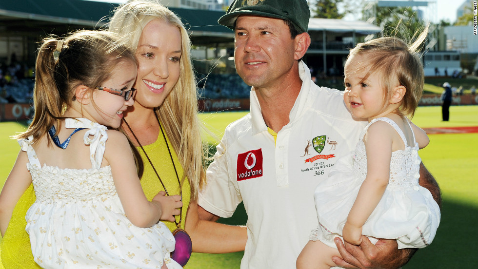 Ponting holds daughter Matisse (R), as his wife Riannna carries daughter Emmy (L), following Australia's defeat in the third and final Test of the series against South Africa at the WACA ground in Perth.