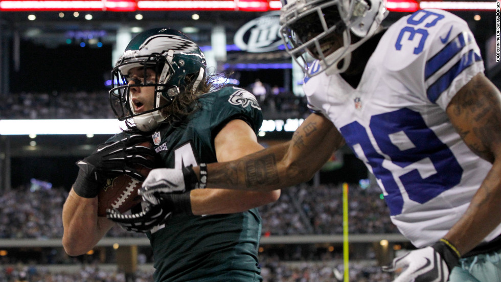 Riley Cooper of the Philadelphia Eagles pulls in a touchdown pass against Brandon Carr of the Dallas Cowboys on Sunday.