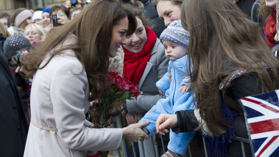 Catherine, Duchess of Cambridge, left, meets 5-month-old James William Davies as she arrives at the Guildhall during her visit to Cambridge on November 28, 2012. Prince William and his wife, Catherine, are expecting their first child, the palace announced Monday, December 3. Click through this gallery to see the her interacting with the younger generation.