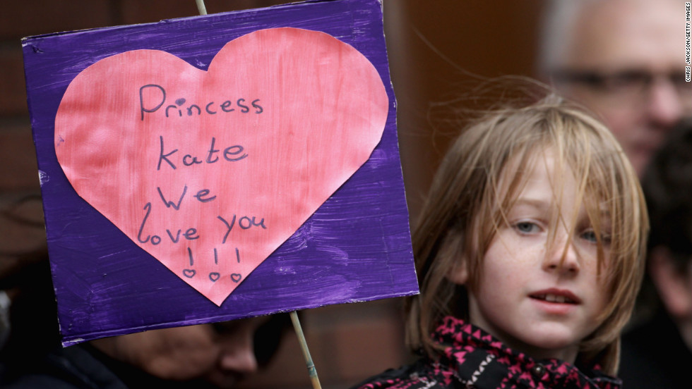 A young child holds up a banner as Catherine visits Alder Hey Children's NHS Foundation Trust on February 14, 2012, in Liverpool, England.