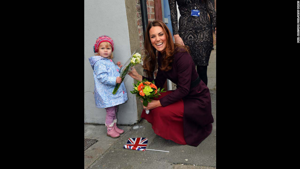 Catherine laughs as she receives flowers from 2-year-old Lola Mackay, who refused to let go of them, during a visit to the CRI Stockton Recovery Service on October 10, 2012, in Stockton-on-Tees, England.