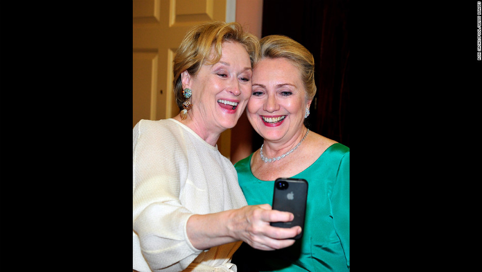 Meryl Streep snaps a picture with U.S. Secretary of State Hillary Clinton after a dinner for Kennedy Center honorees that Clinton hosted at the State Department in Washington on Saturday, December 1.  The 2012 honorees include blues musician Buddy Guy, actor Dustin Hoffman, late-night talk-show host David Letterman, dancer Natalia Makarova, and the surviving members of British rock band Led Zeppelin -- Robert Plant, Jimmy Page and John Paul Jones. An awards ceremony recognized the artists' lifetime achievements to American culture on Sunday, December 2, at the Kennedy Center. Streep was a recipient last year.