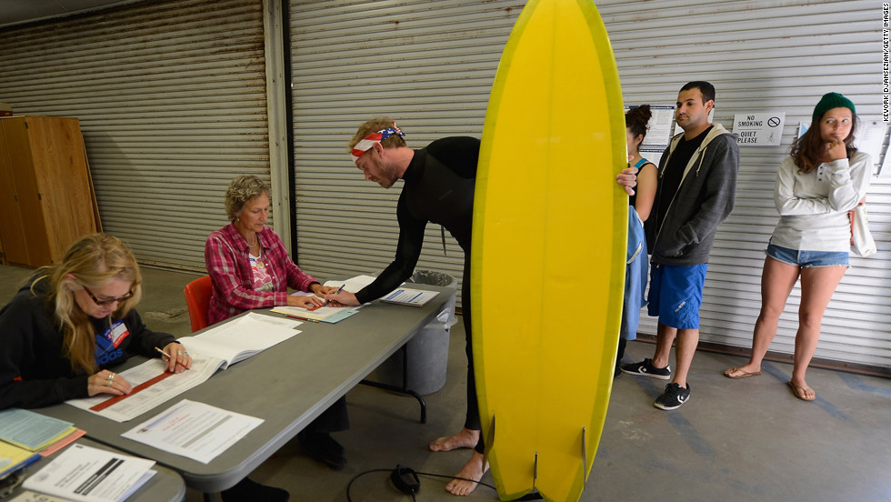 <strong>November 6: </strong>Mike Wigart picks up his ballot at a polling station in the garage of the Los Angeles County lifeguard headquarters. Americans headed to the polls to vote in the race between President Barack Obama and Republican candidate Mitt Romney.
