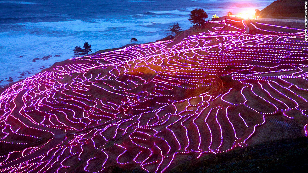 <strong>November 10: </strong>Terraced rice paddies of Shiroyone Senmaida glow with 20,000 solar-powered pink LED lights in Wajima, Japan, to be recorded in Guinness World Records. The rice paddies were registered as Globally Important Agricultural Heritage Systems last year.