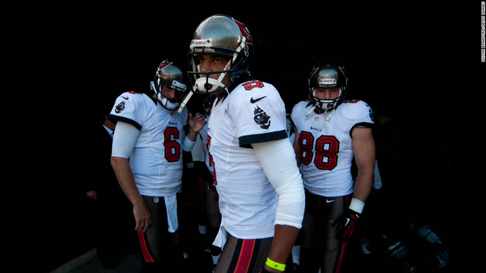 Quarterback Josh Freeman of the Tampa Bay Buccaneers prepares to come out on the field Sunday to warm up before a game against the Denver Broncos at Sports Authority Field at Mile High in Denver.