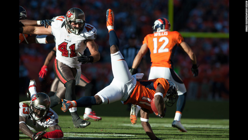 Wide receiver Trindon Holliday of the Denver Broncos is upended as he returns a kickoff on Sunday.