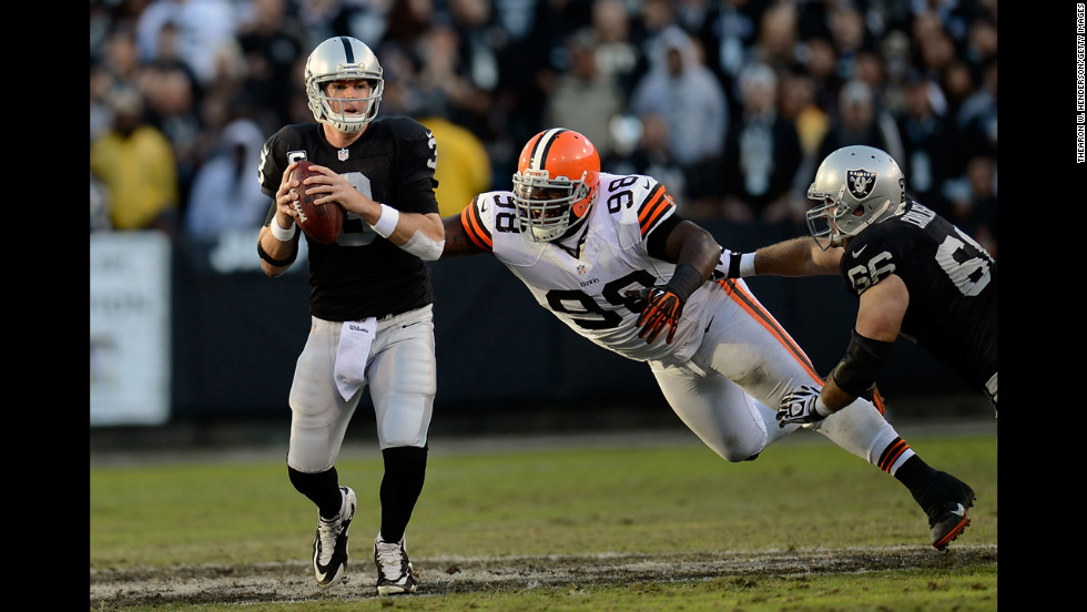 Carson Palmer of the Oakland Raiders scrambles away from the pressure of Phil Taylor of the Cleveland Browns on Sunday.