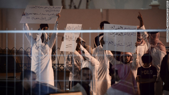 Bahrainis hold up banners Saturday during a protest against Kim Kardashian, who was promoting Millions of Milkshakes.