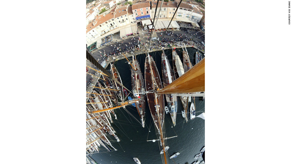 "Kos photographed Saint Tropez harbor from the top of 52 meter schooner Eleonora. ""Whilst guest and crew were chatting on deck and strollers gathered on the promenade, I donned a harness and was hoisted 45 meters aloft,"" she said."