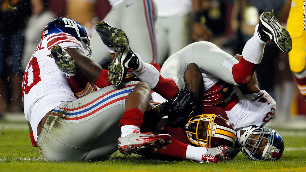 Josh Morgan of the Redskins scores a touchdown after recovering a fumble by teammate Robert Griffin III on Monday.