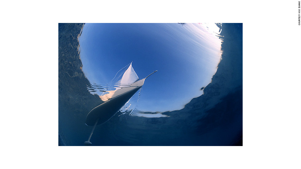 "Kos also took up diving as a way of overcoming her fear of sharks. ""Diving deep takes the colour out of an image. Below 10 meters, everything turns blue, hence the use of a model yacht for these images,"" she said of underwater photography."