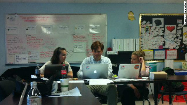 Kickboard CEO Jennifer Medbery, right, meets with engineer Christian Burck and Brenna Benson, of KIPP charter schools.
