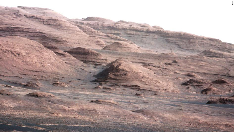<strong>August 23:</strong> NASA's Curiosity rover transmits an image that shows the base of Mount Sharp, its eventual destination. Curiosity successfully landed on Mars on August 6.