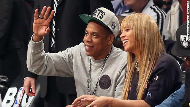 Jay Z and Beyonce attend a Nets game at the Barclays Center.