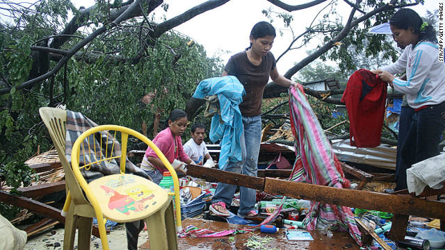 Residents gather their belongings after their house was destroyed by strong winds brought about by Typhoon Bophal earlier this month.