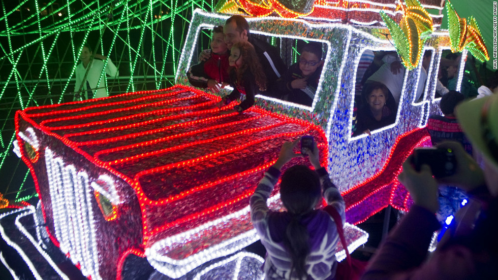 An unusal array of Christmas lights envelop a truck in the city of Medellin, Colombia.