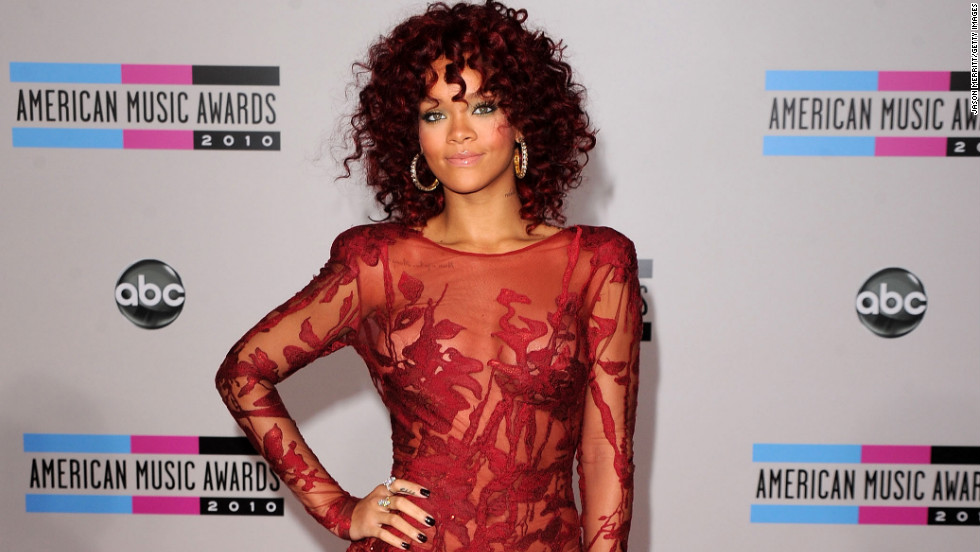 With a slightly longer red 'do, Rihanna arrives at the 2010 American Music Awards in Los Angeles.