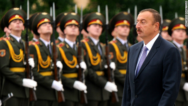Azerbaijani President Ilham Aliyev pardoned a convicted ax murderer after he was extradited from Hungary.