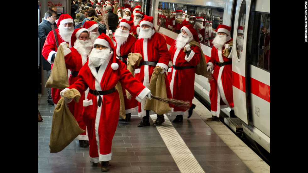 Around 400 people dressed as Santa Claus arrive by train in Frankfurt am Main, Germany, on December 6.