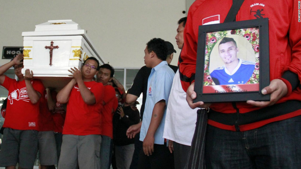 Diego Mendieta's former teammates carry his coffin at the Paraguayan footballer's funeral in Solo, Indonesia.