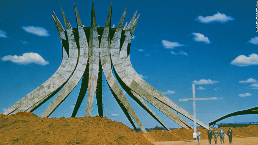 "The cornerstone of Niemeyer's <a href=""http://catedral.org.br/historia"" target=""_blank"">Cathedral of Brasilia</a> was laid in 1958. This hyperboloid structure consists of 16 concrete pillars, each weighing 90 tons, and covers a circular area that is 70 feet in diameter. This photo was taken in the 1960s, but the building was finally inaugurated in 1970."