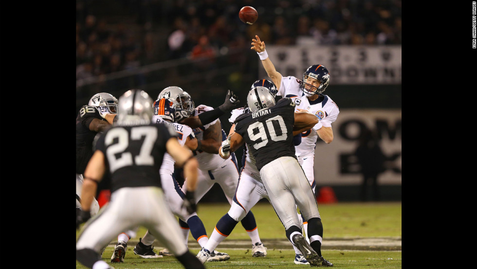 Peyton Manning of the Denver Broncos passes the ball against the Oakland Raiders on Thursday.