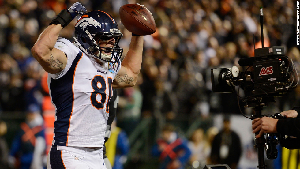 Joel Dreessen of the Denver Broncos celebrates after catching a six-yard touchdown pass against against the Oakland Raiders on Thursday.