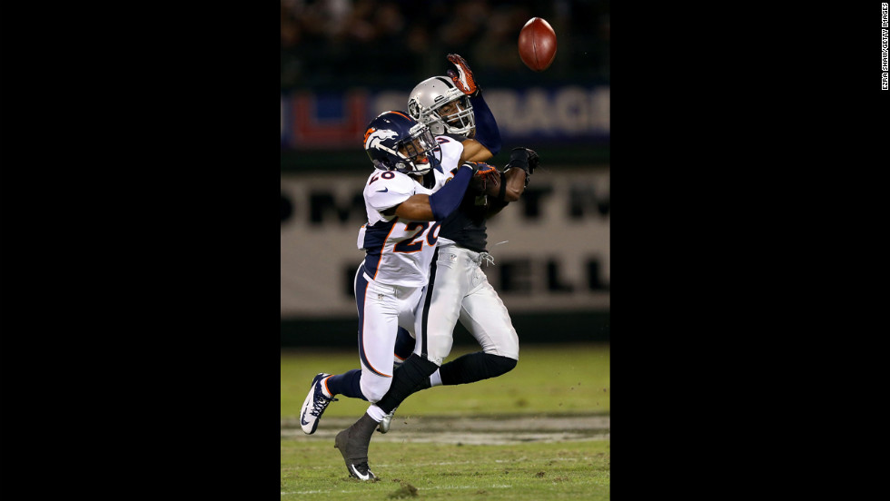 Rahim Moore of the Denver Broncos breaks up a pass intended for Denarius Moore of the Oakland Raiders on Thursday.