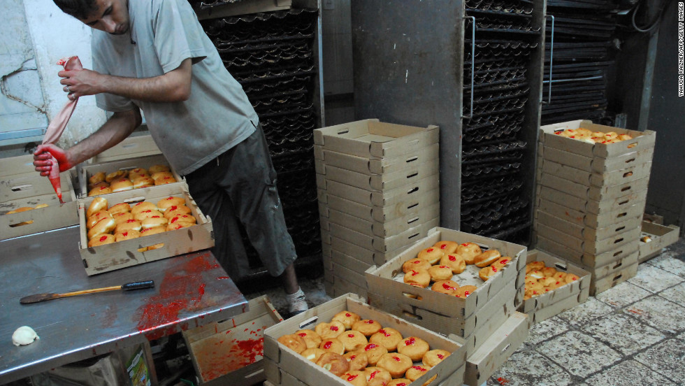 """So popular are the doughnuts in Israel that Jewish-American chef Joan Nathan recalls the local marketplaces resembling a """"pastry auction"""" around this time of year.  Also known as the Festival of Lights, Hanukkah reaffirms the ideals of Judaism and is one of the most popular Jewish observances."""