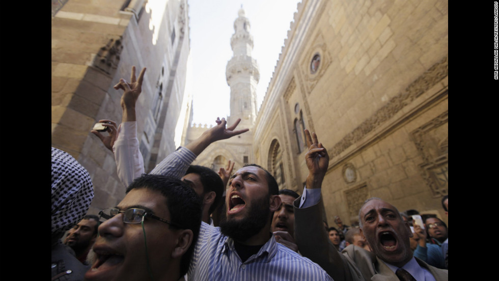 Supporters of Egyptian President Mohamed Morsy and members of the Muslim Brotherhood shout during the funerals of fellow Morsy supporters at Al-Azhar mosque in Cairo on December 7.