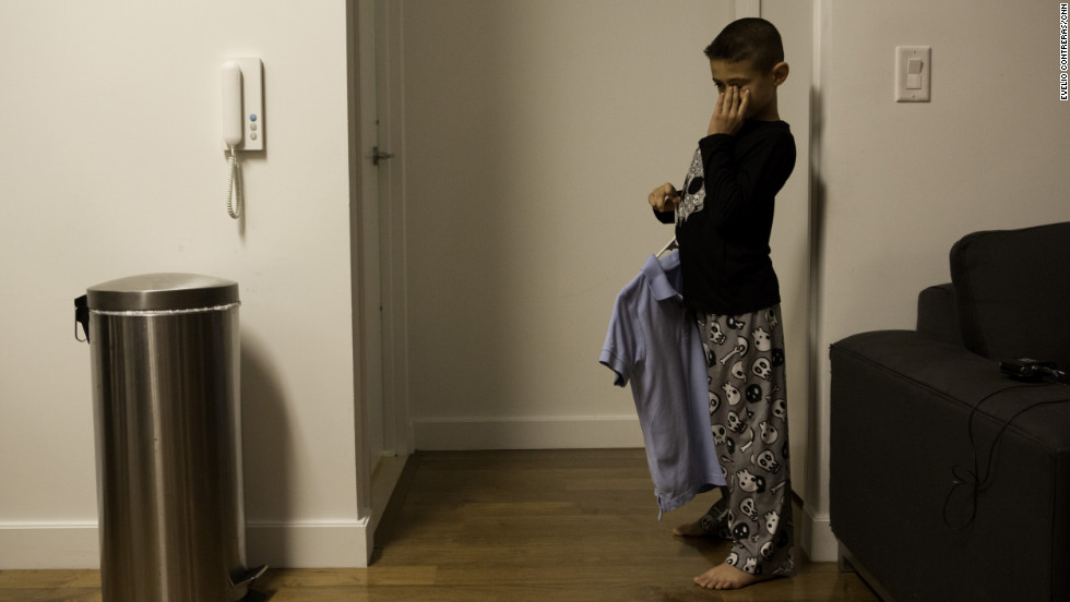 Ryan's younger brother, Christian, 8, wakes up before 6 a.m. at temporary housing in Brooklyn after his family's house in Broad Channel section of Queens was damaged by Superstorm Sandy.<br />