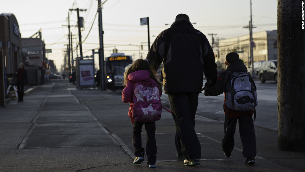 Joe Panetta walks his youngest kids to a bus stop before school.<br />