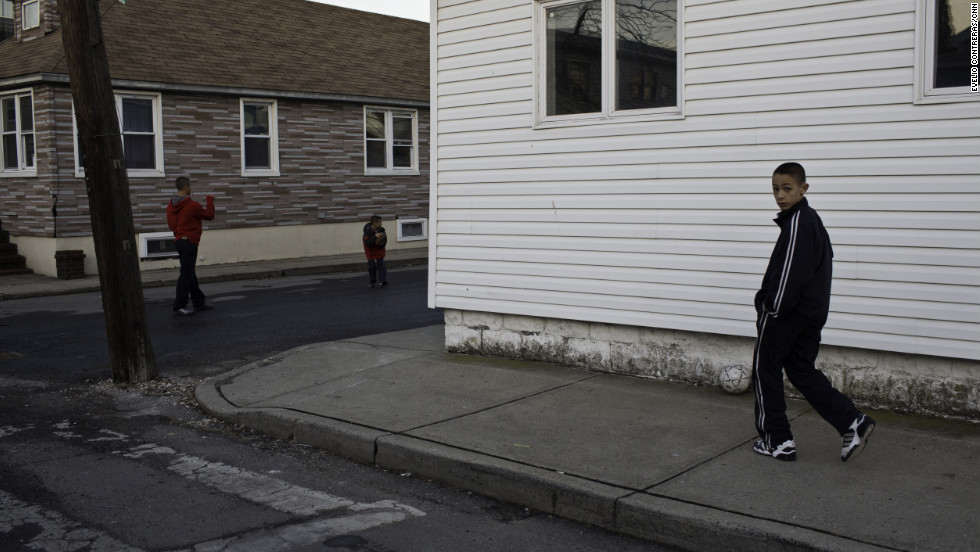 Ryan Panetta and his siblings plays soccer outside his family's home in the Broad Channel section of Queens. They kids and their mom tried to stay in their house during the storm, but escaped to a neighbor's second story.<br />