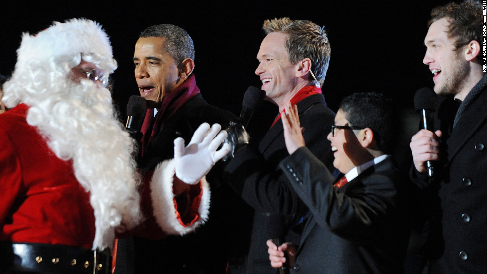 President Barack Obama greets Santa Claus with actors Neil Patrick Harris, Rico Rodriguez and musician Phillip Phillips during the 90th National Christmas Tree Lighting Ceremony at the White House on Thursday, December 6, in Washington, D.C.
