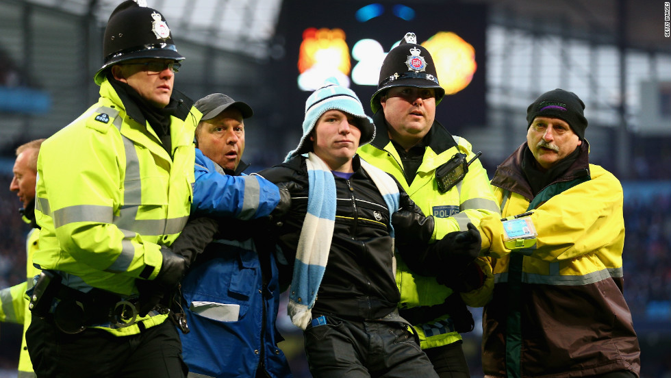 Police intervened to eject the invader, and the Greater Manchester force also announced after the match that another man was arrested inside City's Etihad Stadium on suspicion of chanting racist abuse.