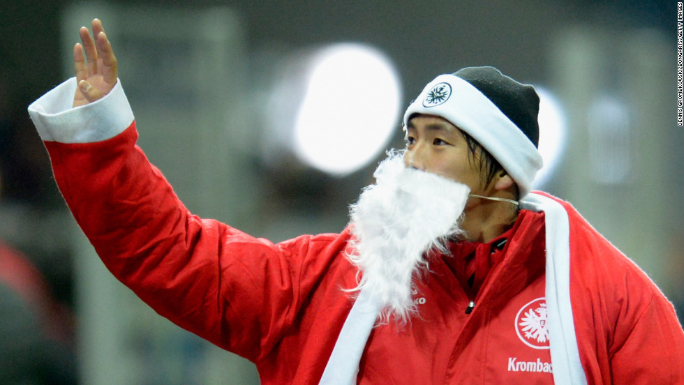 Takashi Inui of Frankfurt, Germany, celebrates dressed as Santa Claus after the Bundesliga match between Eintracht Frankfurt and SV Werder Bremen on December 8 in Frankfurt am Main, Germany. Eintracht won 4-1.