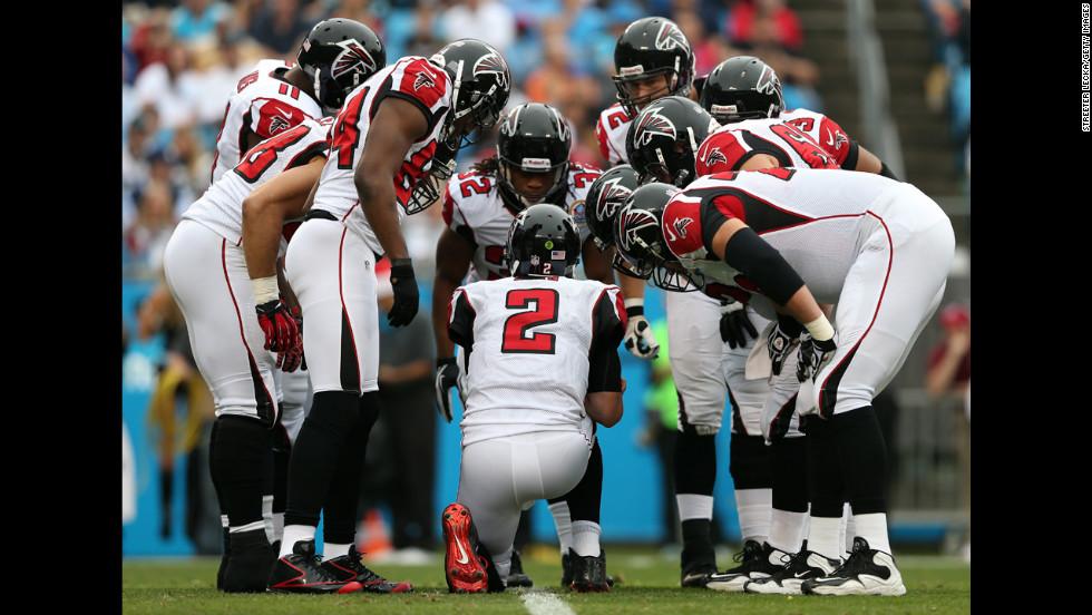 Atlanta Falcons quarterback Matt Ryan calls a play in the huddle against the Carolina Panthers at Bank of America Stadium on Sunday in Charlotte, North Carolina.