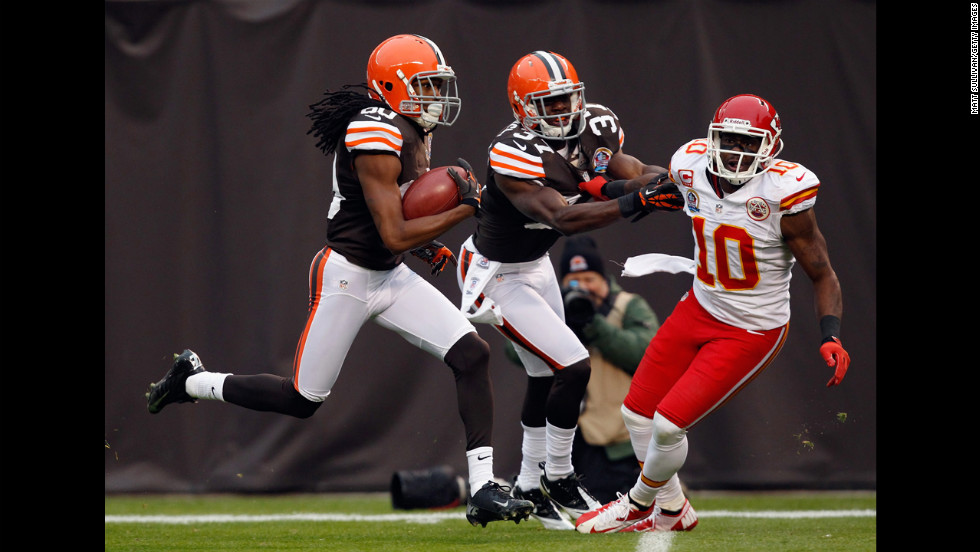 Cleveland Browns wide receiver Travis Benjamin gets a block from teammate Johnson Bademosi on Kansas City Chiefs wide receiver Terrance Copper at Cleveland Browns Stadium on Sunday in Cleveland, Ohio.
